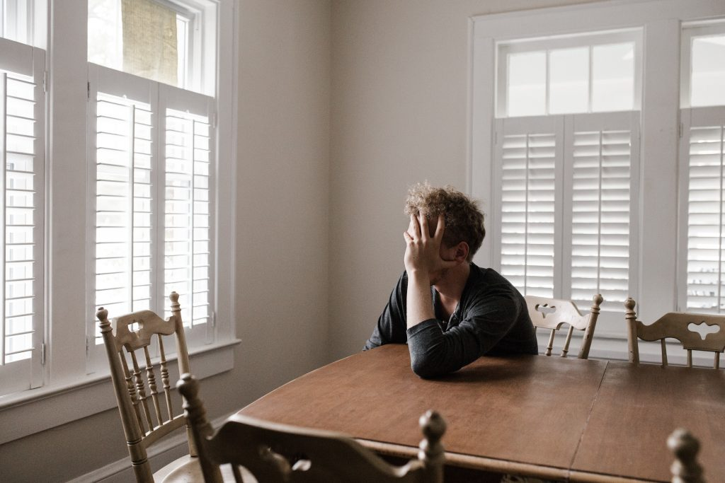 guy thinking in dining room