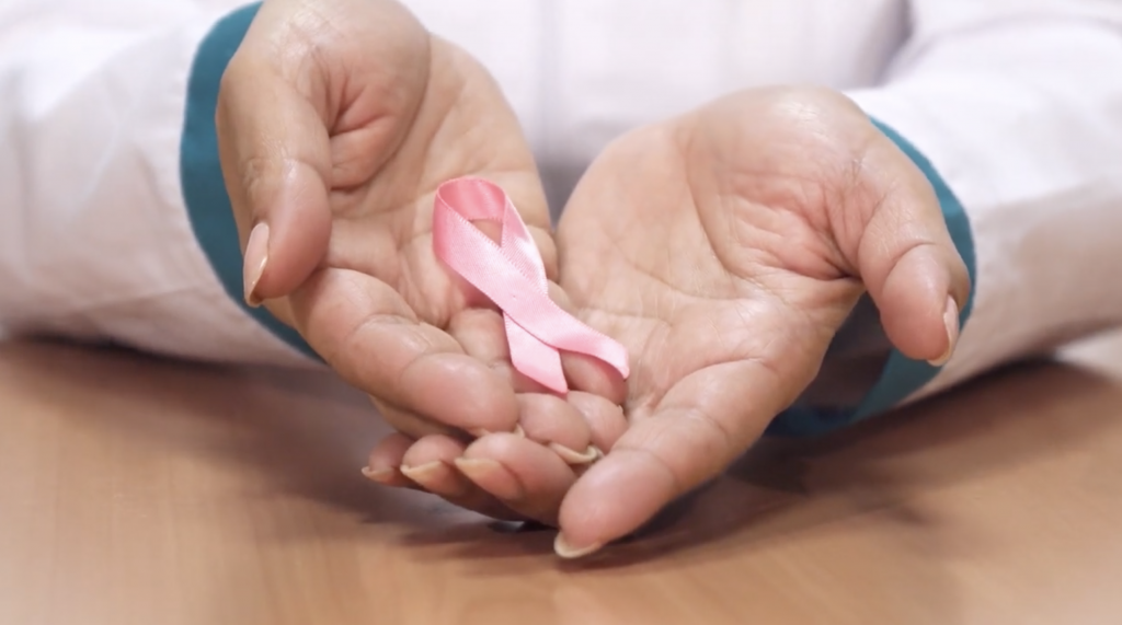 hands holding breast cancer ribbon