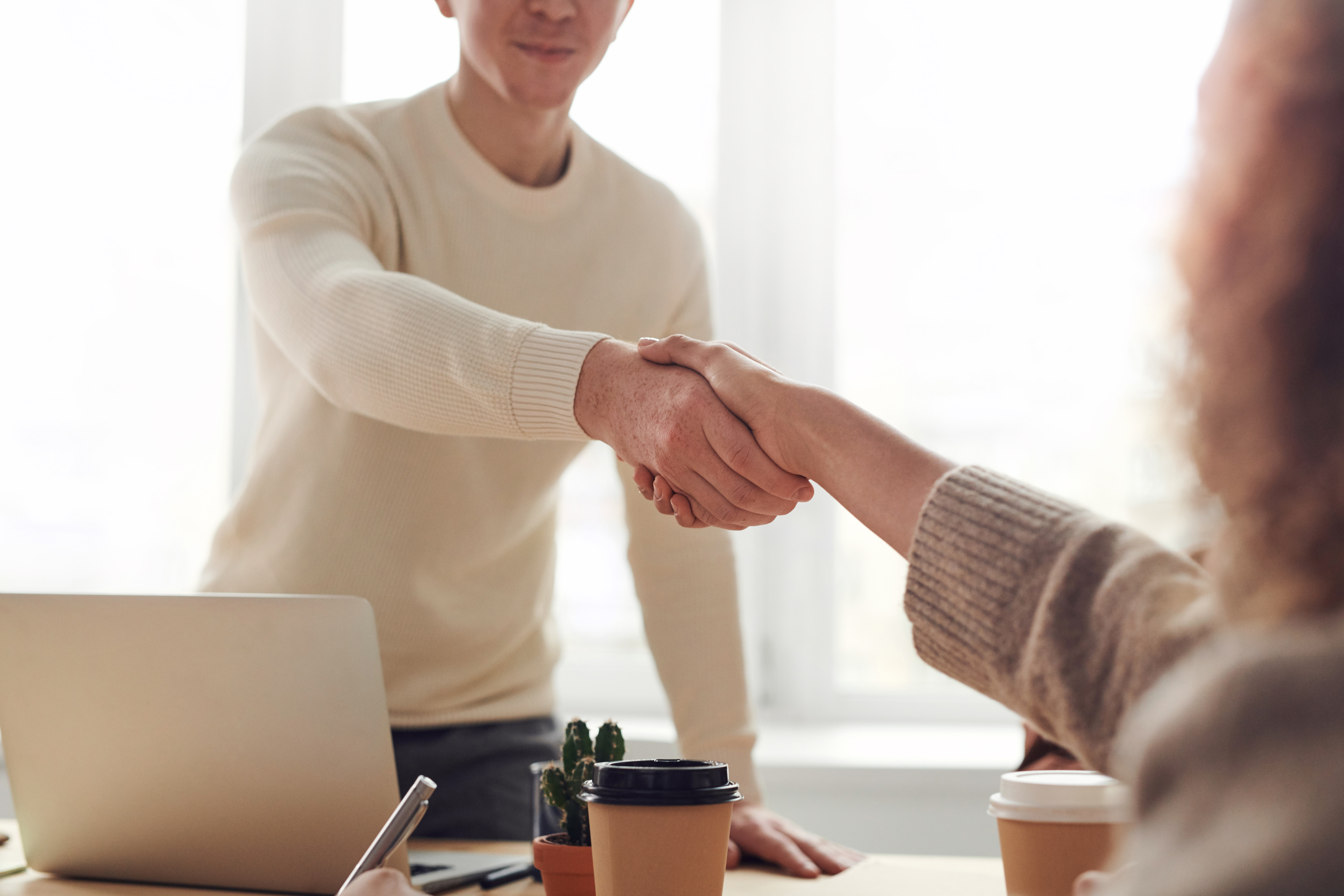 Couple shaking hands
