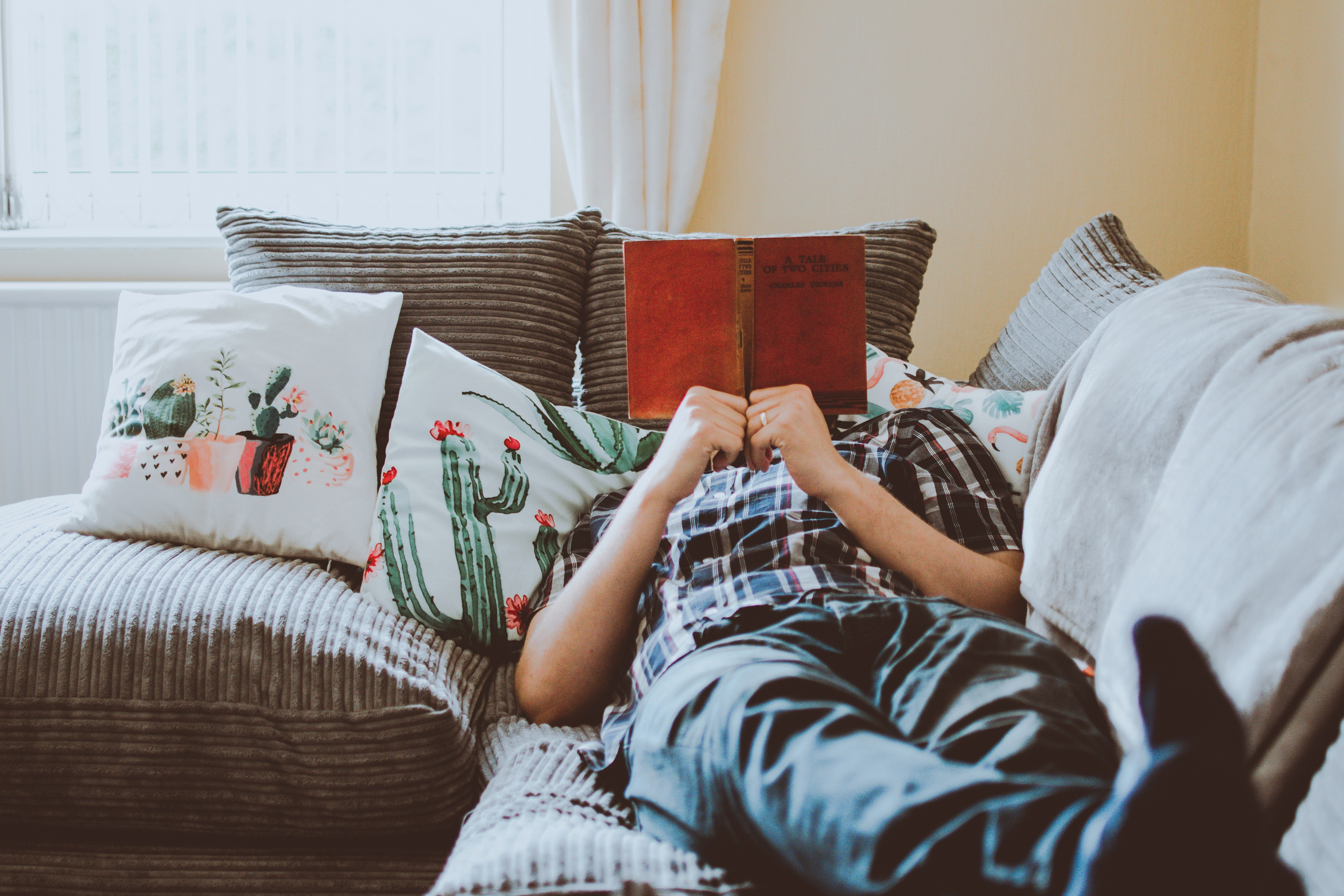 Man reading on couch