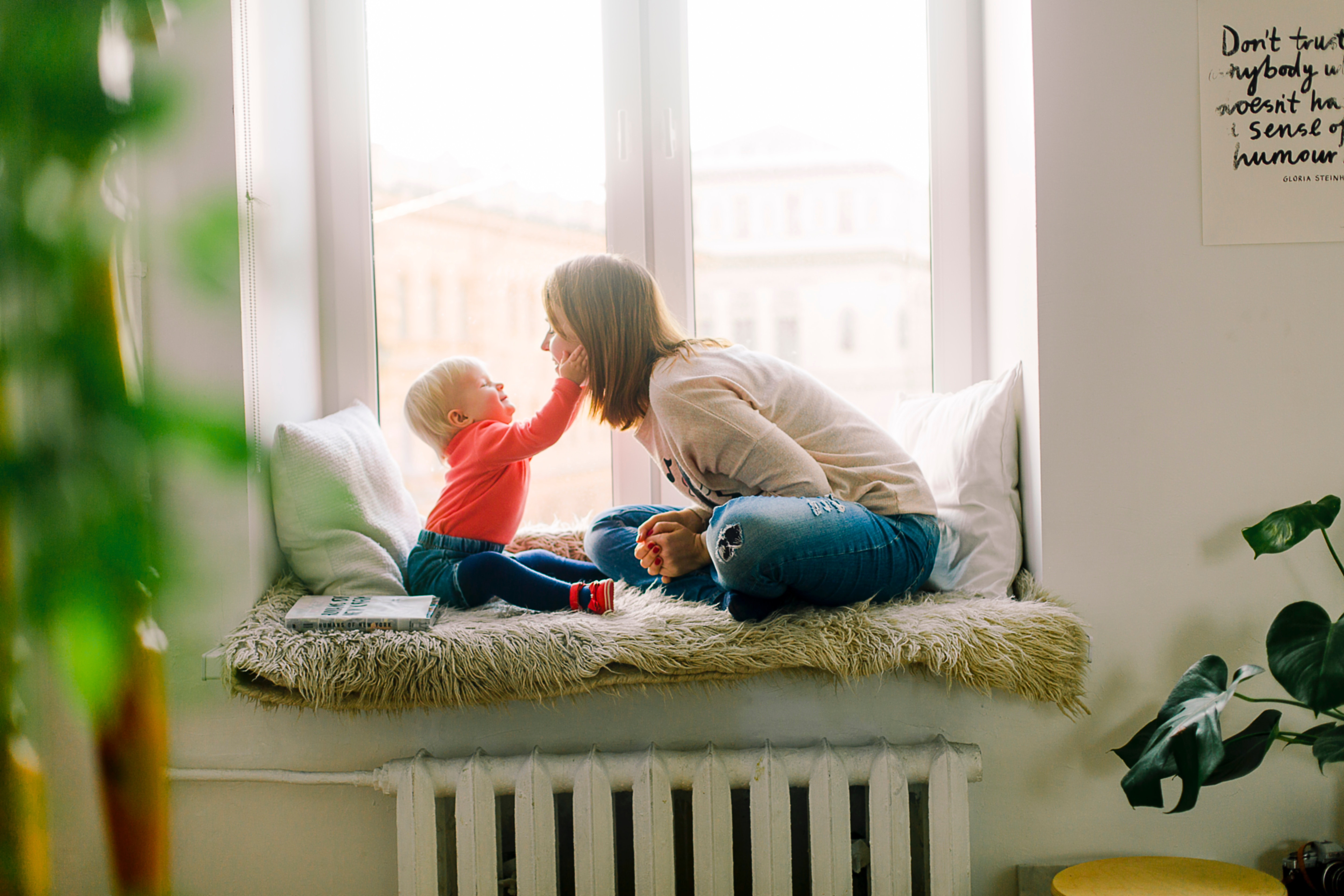 Playing with kid in window